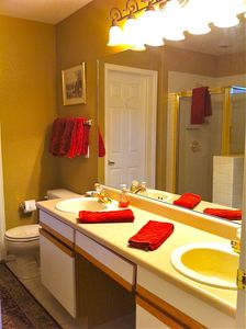 Master bath with double sinks, separate shower and oversized tub.