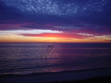 Cape Charles estate rental - Tremendous sunsets are seen right from the beach or the large wrap-around deck.