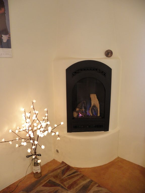 Enjoy the Kiva fireplace...without the mess!