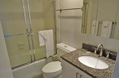 New hallway 2nd bedroom bath, mirror cabinets, granite, extra towel racks-