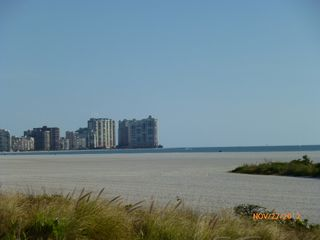 South Seas Club condo photo - Looking south down beach from beach enterance @ condo just behind pool