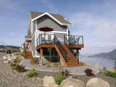 Cottage with deck and walkway overlooking Lake Okanagan. Fully landscaped.