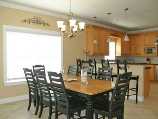 Farm table with plenty of seating and large kitchen