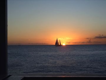 Sunset and sailboat taken from deck -- amazing sunsets and stars at night.