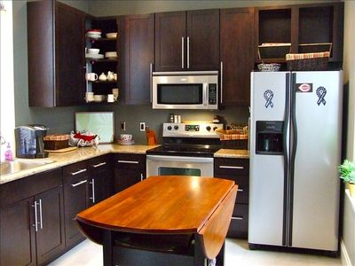 Kitchen: up-to-date appliances, thoroughly equipped, including custom coffee.