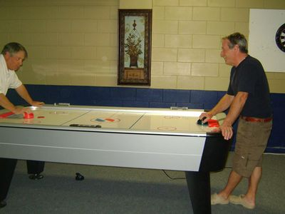 Terra Verde house rental - air hockey tournament between my dad and my godfather!