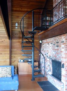 Stairway to the upstairs where there are two bedrooms and a loft reading area