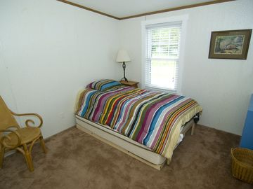 "Bedroom 3 with twin bed (6"" longer than std.) and pull-out twin trundle bed."