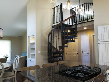 Capitola apartment rental - Living area with staircase going to loft.