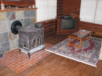Wood burning stove keeps the entire cabin warm--(cabin has heat and A/C also)