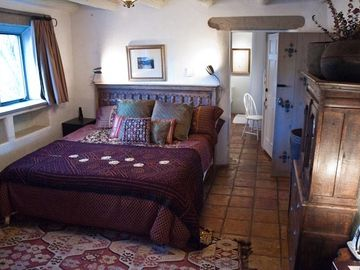 King Sized Tempurpedic Bed with View of Taos Pueblo Lands and Mountains