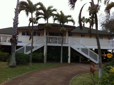 House from front with large deck made of Ironwood. Pole house is cool year round