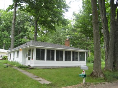 Interlochen cottage rental - Large screened in porch on the front of the cottage for dining or relaxing.