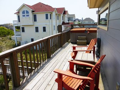 Top level deck with hot tub.