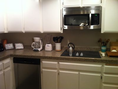 well-stocked kitchen with new stainless steel appliances & more