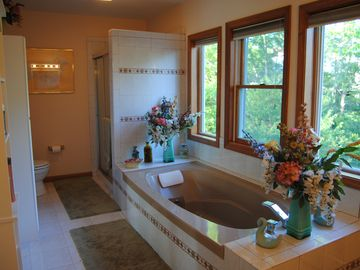 Private bath with jetted tub and shower