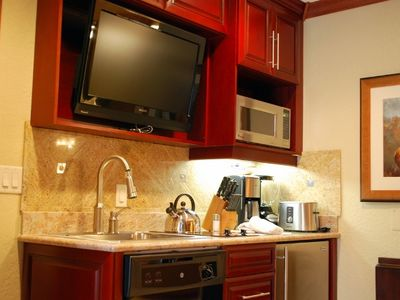Kitchenette Includes Flat Screen TV, Sink, Dishwasher, Microwave, Mini Fridge