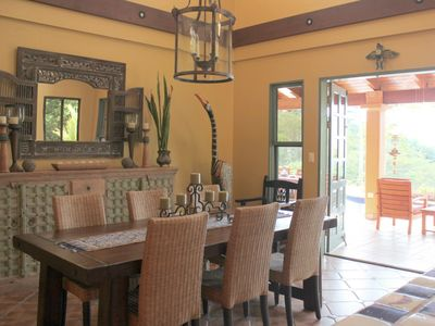 French doors lead from the dining room to the poolside veranda