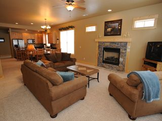 Estes Park condo photo - Living Room with Cozy Fireplace and satellite T.V. (in each 3 bedroom condo)