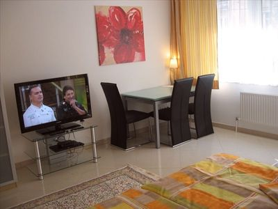 40' HD LCD TV with satellite receiver and large table for dining - Vienna Center
