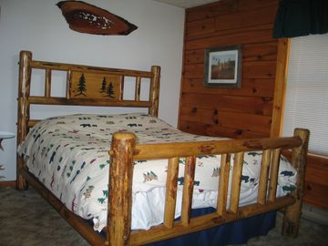 Log bed in master bedroom