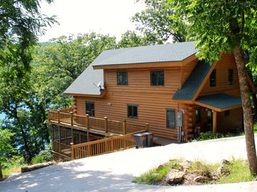 Eureka Springs cabin rental - Luxury log cabin right on Beaver Lake (see the lake in the background!)