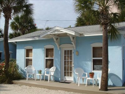 Adorable ground floor beach cottage with new wrap around decking!