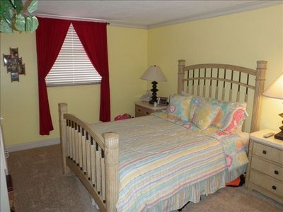 Spacious guest bedroom with queen bed