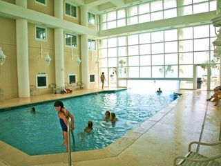 Indoor pool connects to the outdoor pool - Majestic Sun condo vacation rental photo