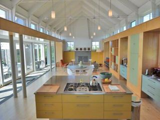 Katama house photo - Great Room Features Vaulted Ceiling, Wall Of Glass Windows & Doors That Open Out To Pool & Patio Areas