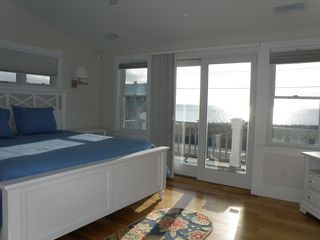 Truro house photo - Top floor master bedroom with deck and views of the bay and lighthouses.