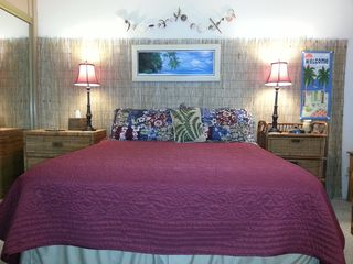 Queen bed with extra pillows, clock/radio with soothing sounds, table lamps - Corpus Christi condo vacation rental photo
