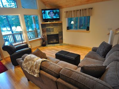 Comfortable sectional couch and a gas fireplace on the main floo