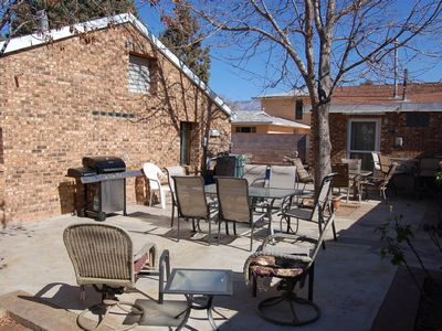 Back patio with outside bar in December, guest house in back drop.