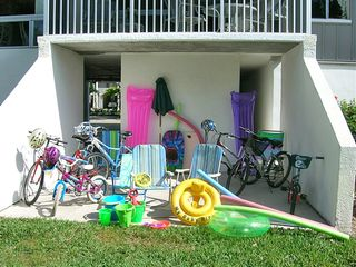 Sanibel Island condo photo - Secure storage area with Bikes, chairs and beach toys for your use