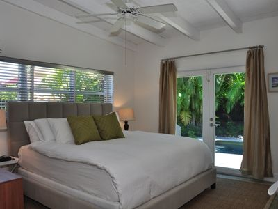 King Bedroom with pool access, luxury linens, LCD TV