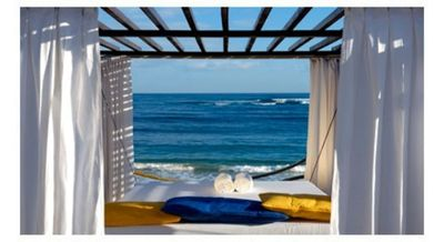 Look out at the ocean from your bed at VIP Beach
