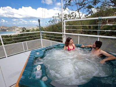 Relax and unwind in the rooftop hot tub