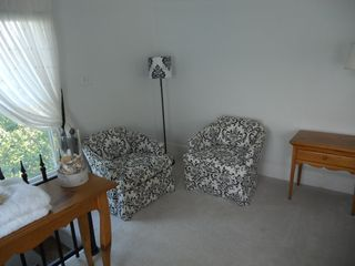 Cape Charles house photo - Seating area in master bedroom 1. Perfect for reading a book or magazine