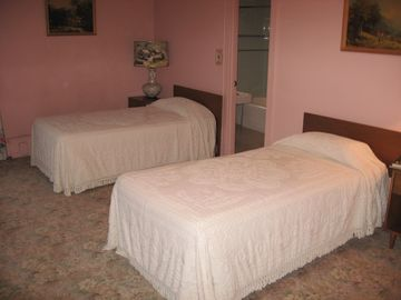 Pink master bedroom - 2 single beds