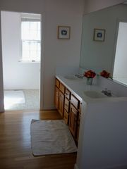 Hyannis - Hyannisport house photo - Master sinks with bath/shower in background