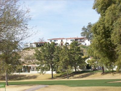 View of Wrigley Mansion Directly Above Property