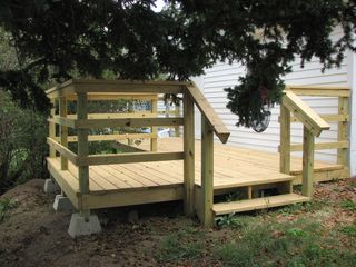 Lead cottage photo - Deck at back of property, great views of staging area for 4th of July fireworks