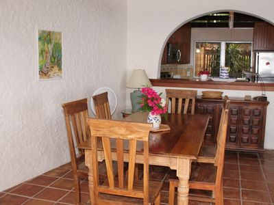 Indoor dining area with seating for six is conveniently located next to kitchen.