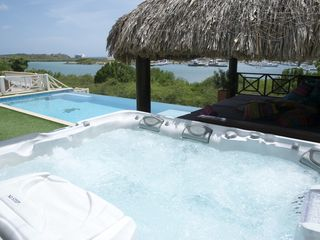 Curacao villa photo - Enjoy the great view from the hot tub just a step away from the infinity pool