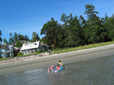 Parksville condo rental - Rathtrevor Beach, with unit/complex in back (on mid-bank)