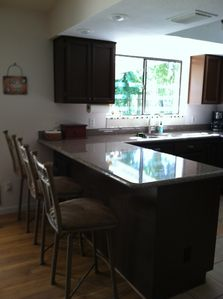 Breakfast bar with granite countertops.