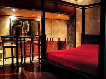 Four poster teak bed one.