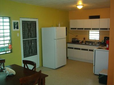 The newly remodeled kitchen complete with microwave and utensils for cooking.