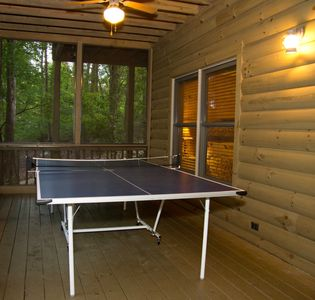 Downtairs ping pong table, lower level screened porch adjacent to hot tub